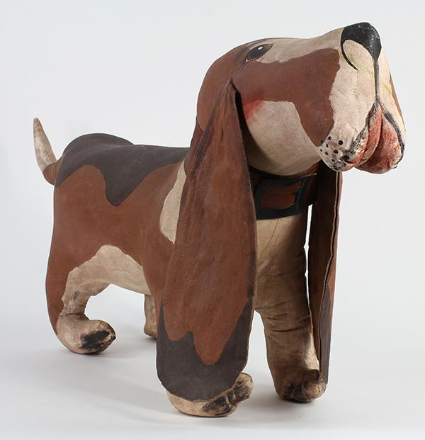American Folk Art hound dog, the canvas form stuffed and hand-painted with polychrome features, 14
