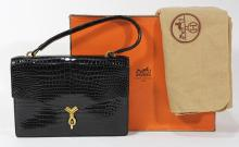 Hermès of Paris black crocodile `Cordeliere'' handbag, circa 1970,  with rope-twist clasp and links to the curved handle, soft black ..