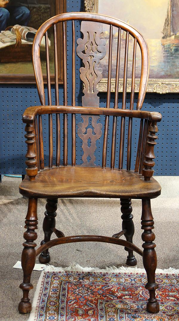 English Windsor yew and elm high back armchair, in the manner of Thomas Simpson (1830-1850), having a spindle back, with continous a...