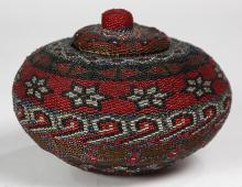 Native American Indian style fully beaded basket, the lidded bulbous form with bold geometric designs and six point star motifs, exe...