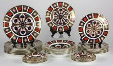 (Lot of 32) Royal Crown Derby Imari table service for eight, in the classic Imari pallet of navy, orange, and gold, having the Royal...