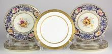 (lot of 13) Royal Doulton dinner plates, each having a scalloped gilt rim, centering floral sprays on a cream ground, 10