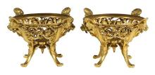 Pair of French Barbedienne gilt bronze center pieces, 19th century, each having a circular pierced bowl with figural mounts, above f...