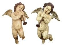 Pair of Italian Rococo style polychrome decorated figural sculptures of winged putti, each depicted playing a trumpet, 21