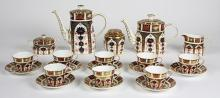 (Lot of 21) Royal Crown Derby Imari drinks service for eight, in the classic Imari pallet of navy, orange, and gold, having the Roya...