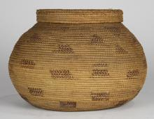 Native American woven basket, early 20th Century, likely Pacific Northwest, the bulbous form narrowing to a vertical rim with a fitt...