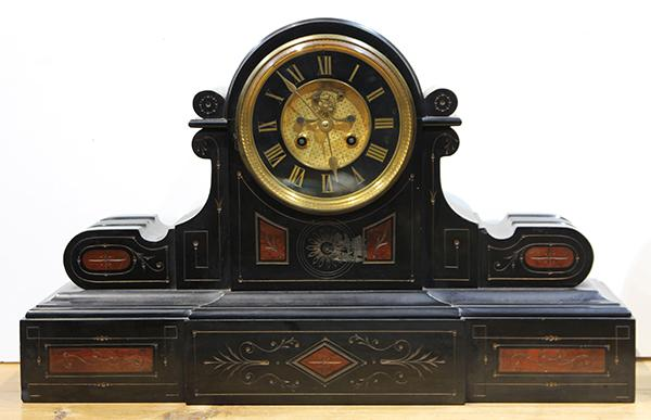 French mixed marble mantle clock, having a Roman numeral dial above the shaped case in red and black marble, 13