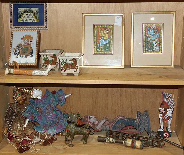 Two shelves of asian decorative items for Shelf decor items