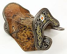 Carved and metal inlaid saddle