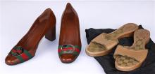 Two pair of Gucci shoes, consisting of a wood platform sandal, size 8; together with a brown leather pump, size 7B