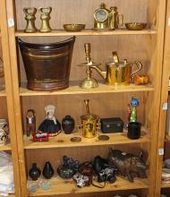 Four shelves of brass nautical and apothicary articles, including weights, candlesticks, a mortar with pestal, together with an Anri...