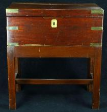 English campaign style lap desk on stand, 19th century, having a felt writing surface and rising on a later stand,  20