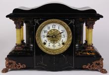 Seth Thomas mantle clock, early 20th Century, the ebonized case with faux marble pillasters and ormolu brass mounts framing the inse...