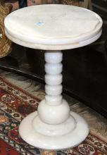 Moderne marble occassional table, having a circular top, above the shaped base, 20