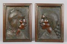 (lot of 2) Pair of Mexican carved wood figural plaques by Flores Arias, depicting a the profile of a man and woman in ethnic attire,...
