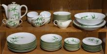 Two shelves of Bamboo Japanese porcelain dinner service in the