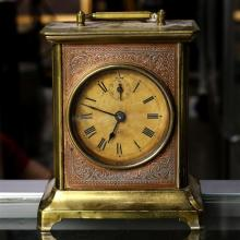 Seth Thomas brass and copper carriage clock, the round face with roman numerals, 7