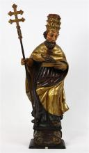 Continental polychrome decorated Santos figure, late 18th/19th century, depicting Saint Vincent of Saragossa, wearing a head piece, ...