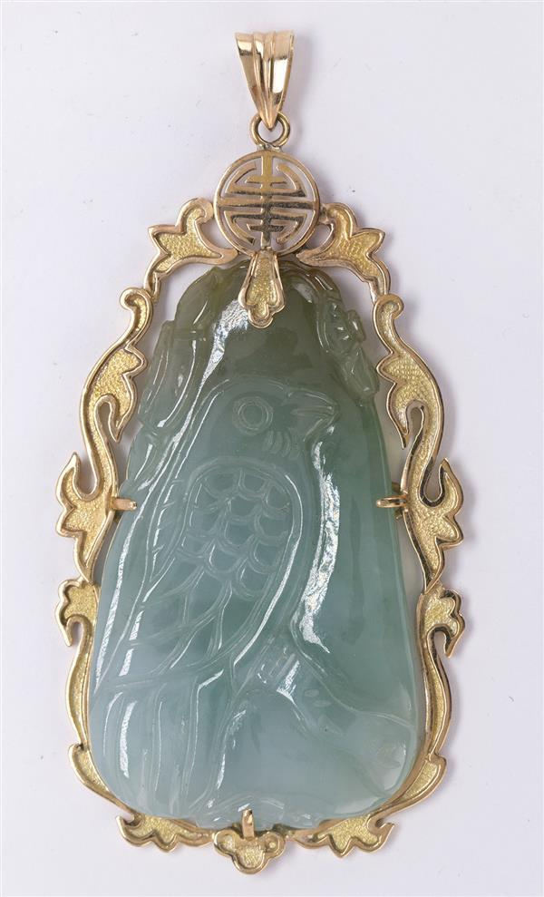 Carved jadeite and 14k yellow gold pendant