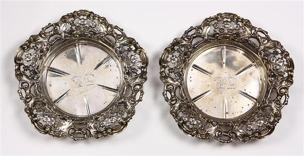 Pair of Victorian sterling silver wine coasters, London, 1840, by Mortimers & Hunt, the scalloped rim with reticulated and chased fl...
