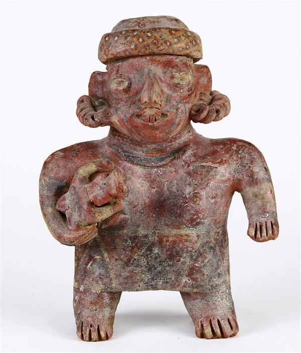 Pre-Columbian ceramic figure, Jalisco culture, 200 BCE-CE 200, depicting a standing female with bare breasts and truncated arms hold...