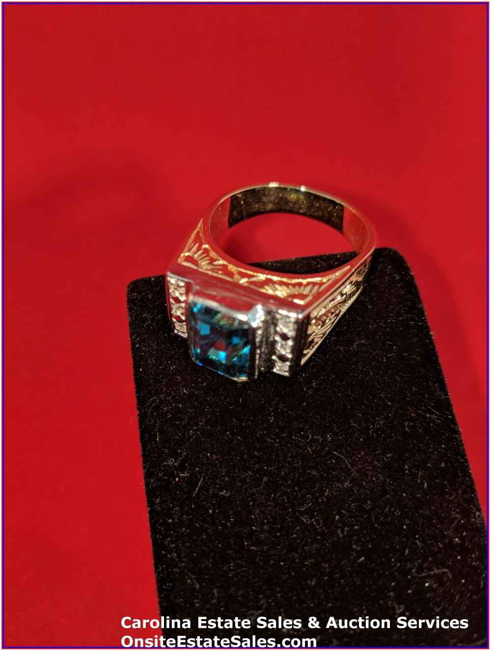 18K Gem Ring Gold 15 Grams Total Weight; with 10 ct Blue Zircon Center Stone