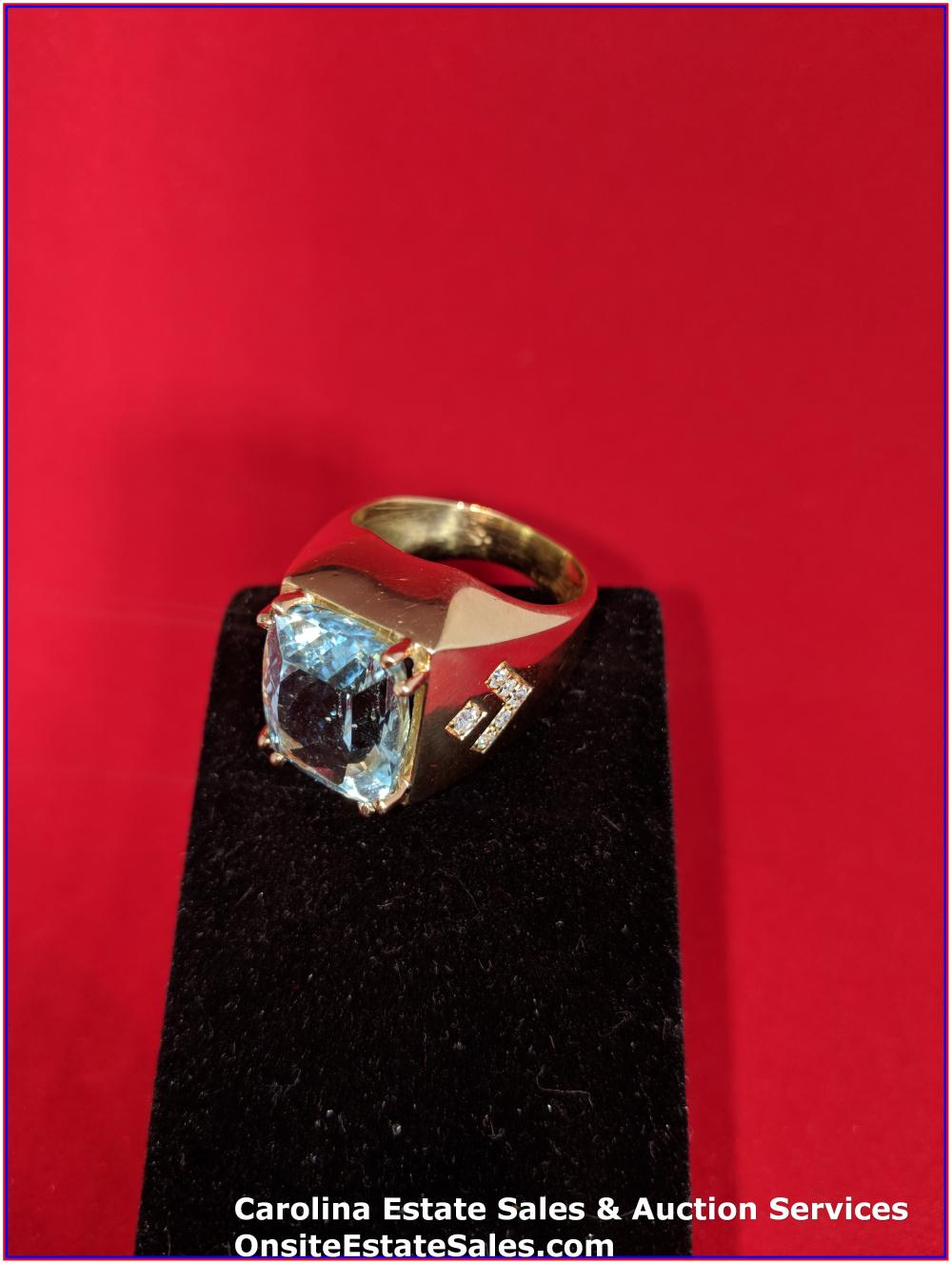 14K Gem Ring Gold 45 Grams Total Weight; 25 ct Blue Topaz Center Stone surround by 2 ct Diamonds