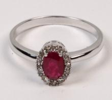 14K WHITE GOLD DIAMOND AND RUBY LADY'S RING HAVING 0.41 CT RUBY AND O.O7 CTW DIAMONDS