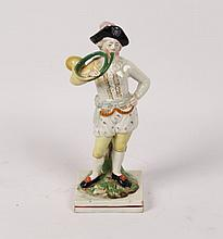 EARLY STAFFORDSHIRE FIGURE OF YOUNG BOY WITH BUGLE