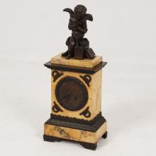 19TH C. BRONZE AND JAUNE MARBLE FRENCH CLOCK WITH PUTTI SURMOUNTS