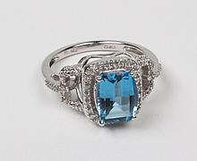 14K DIAMOND AND BLUE TOPAZ RING