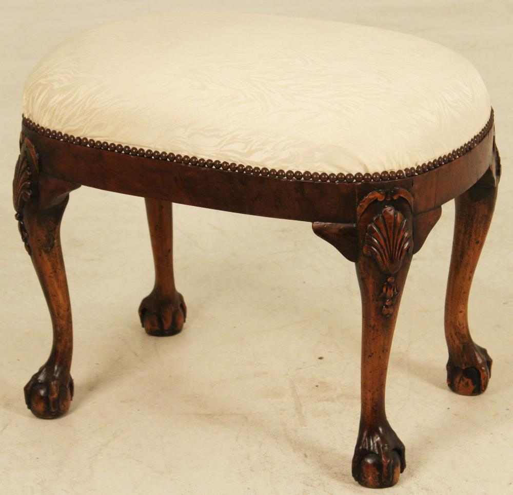 Lot 96: ENGLISH BALL AND CLAW OVAL WALNUT STOOL