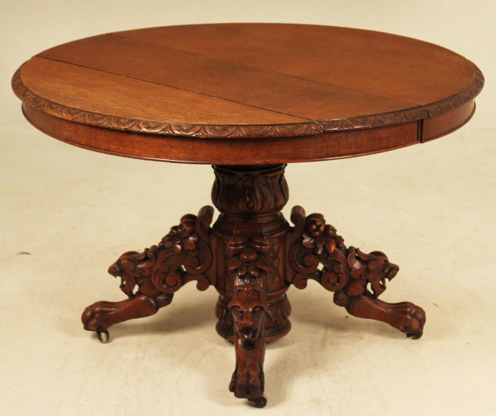 Lot 129: EUROPEAN OAK LION CARVED BREAKFAST TABLE