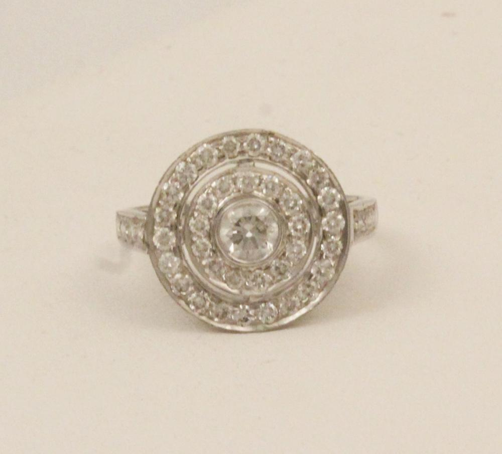 Lot 152: 18K GOLD DIAMOND SPIRAL FORMED RING