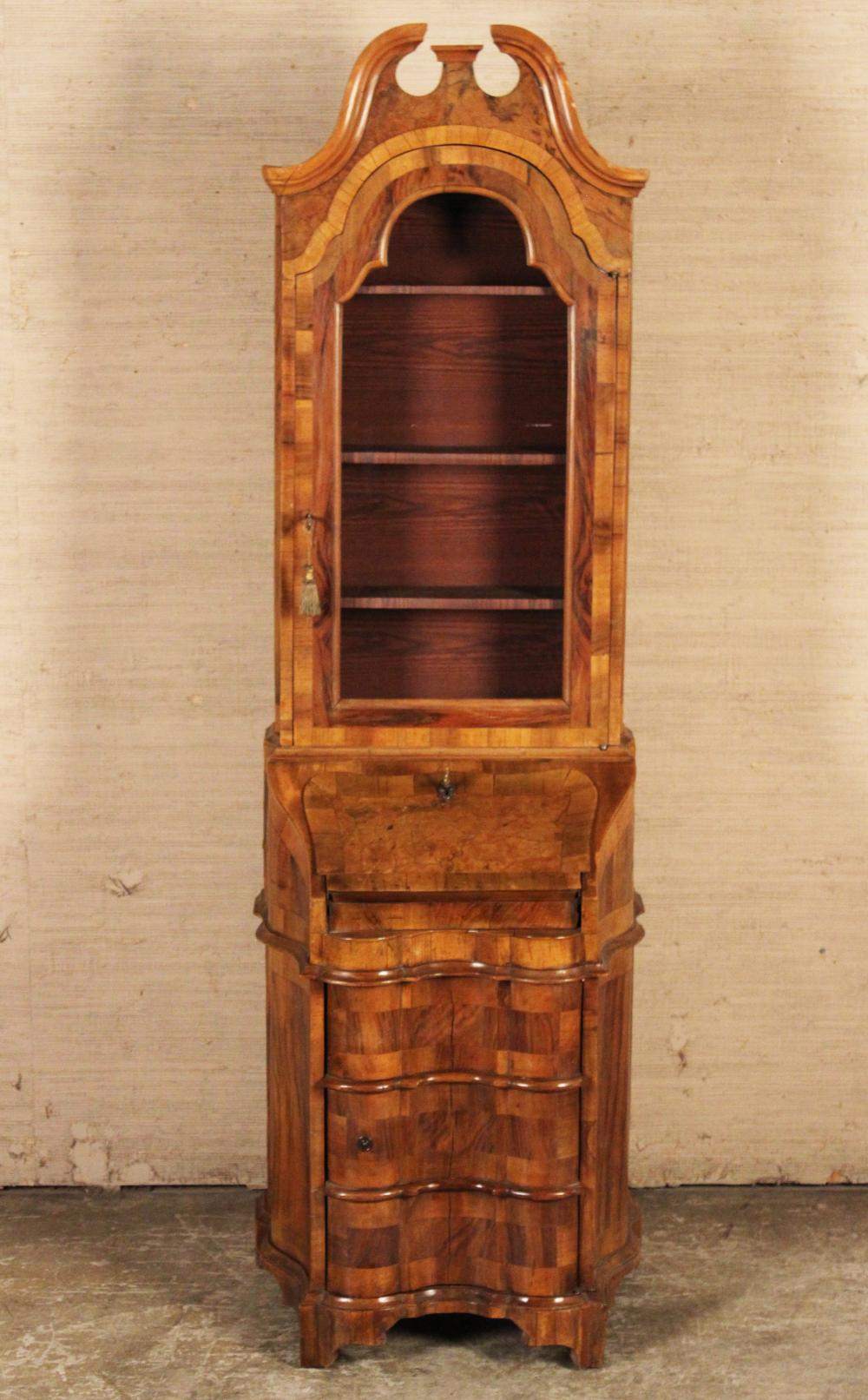 Lot 163: CONTINENTAL WALNUT SHAPED FRONT BOOKCASE