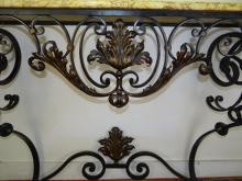 Lot 139: FRENCH WROUGHT IRON AND M/TOP CONSOLE