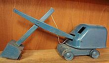 3. Antique Metal Excavator Toy Vehicle