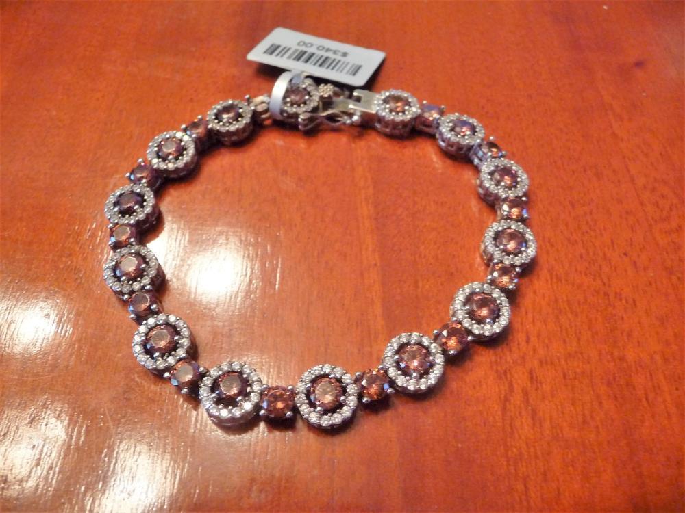 CHAMPAGNE AND WHITE DIAMOND HALO TENNIS BRACELET