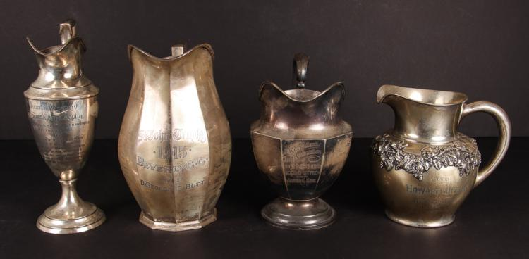 Four Pitcher Style Sterling Golf Trophies