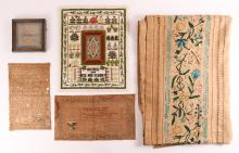 A collection of samplers and crewel work bed cover