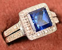 2.12ct Sapphire w/.10ct diamonds 10KT size 6.5