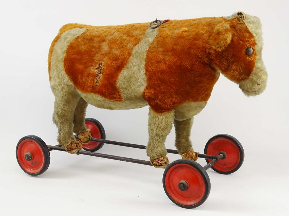 Early Cow Roller Toy