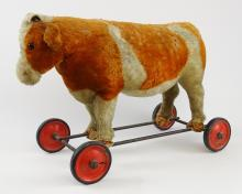 Lot 182: Early Cow Roller Toy