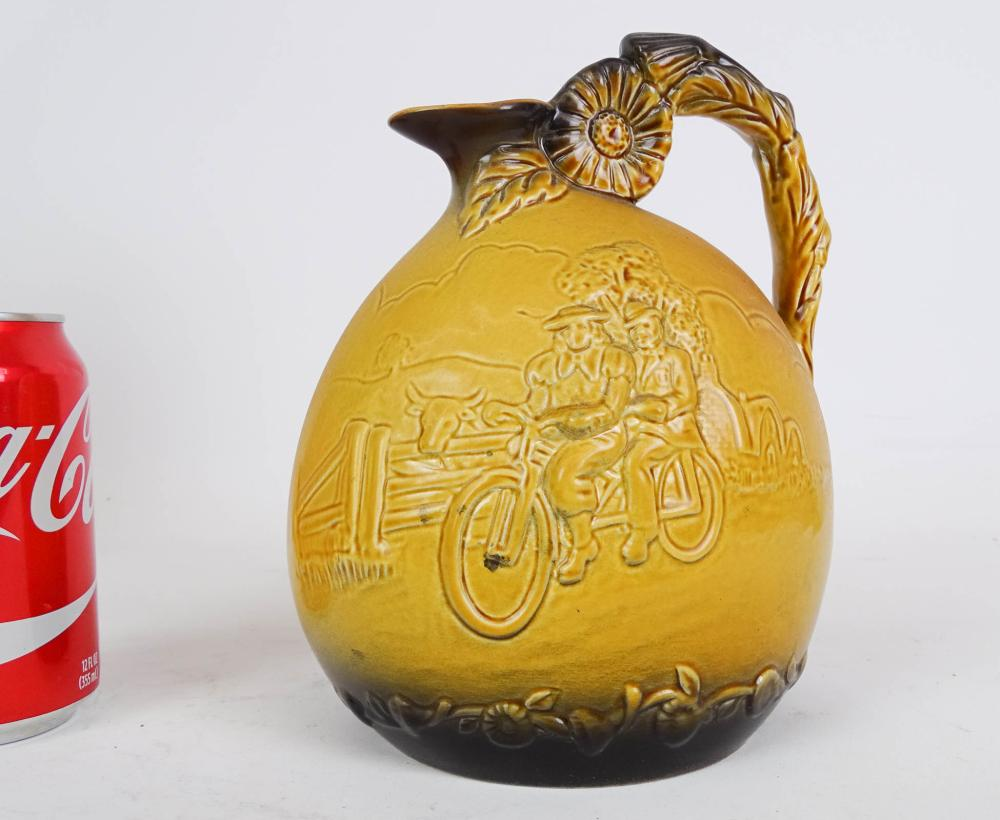 Ceramic Pitcher With Figures On Bicycle