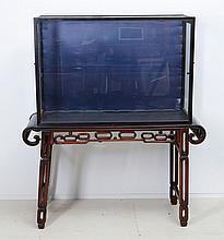 TABLE WITH AN ORIENTAL DISPLAY CASE