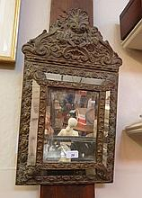 A Venetian wall mirror, with foliate copper