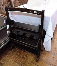 A twentieth century wooden boot stand
