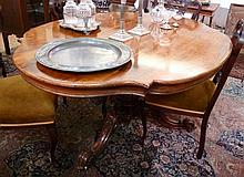 Victorian rosewood veneered loo table, the shaped