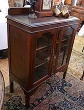 Twentieth century oak display cabinet, pair glazed