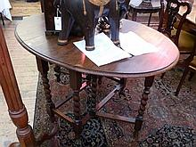 Twentieth century oak gateleg table, on spiral